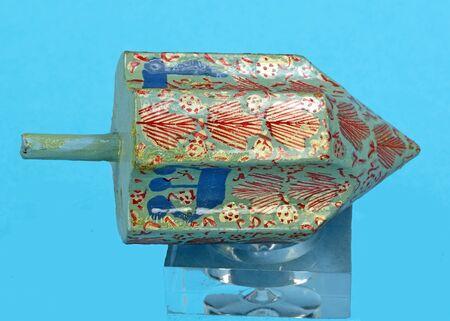 hebrew alphabet: Chanukah dreidel on a blue background.
