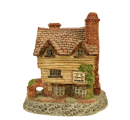 Miniature of wine merchant building on a white background.