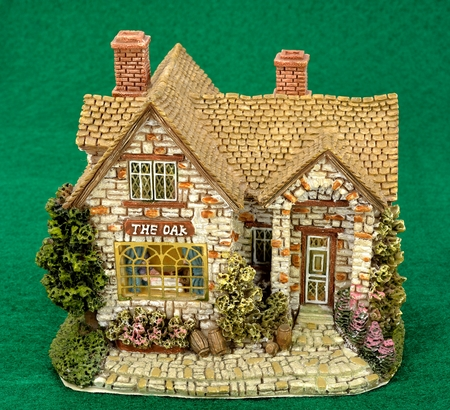Miniature of a building on a green background. Stock Photo