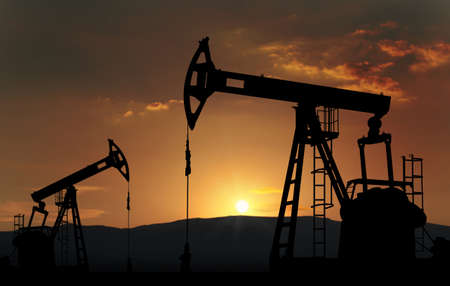 oilwell: oil pump jack against sunset Stock Photo