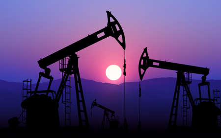 drilling well: oil well plant against sunset