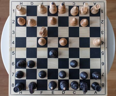 chess game at home. A two-man game is a home game. white and black figures. it's a normal apartment. the best game is developing mental abilities. chess as a symbol of a true leader