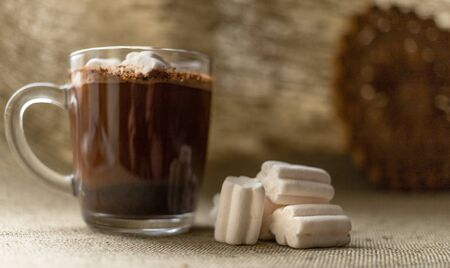 Mug of coffee and marshmallows in the basket. Beautiful and delicious for breakfast. High quality photo. The perfect start to the day. Lovely drink with sweets. Great option for children and adults