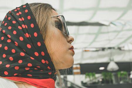 facial portrait of a beautiful white woman in black sunglasses. High quality photo Фото со стока