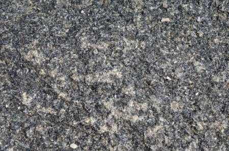 speckle: Close view of gray granite with speckling from white to black