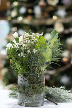 etched: Christmas floral arrangement with white, green, and frosted etched glass vase Stock Photo
