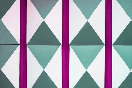 Abstract white, green and purple pattern wooden texture background. Old door decoration close up