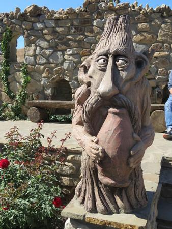 original: wooden creature original sculpture Stock Photo