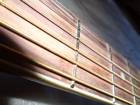 Close-up acoustic guitar fretboard