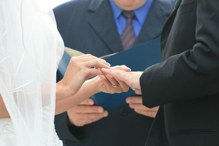 placing the ring on his hand Stock Photo
