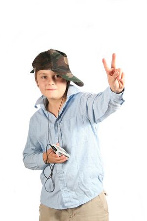 Cool child listening to music on player