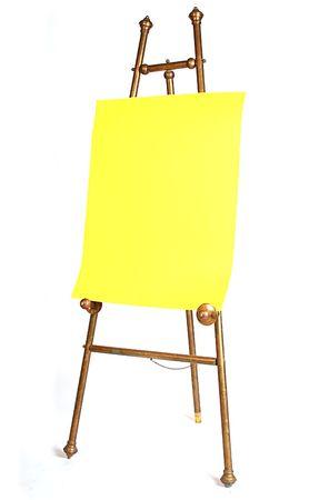 antig�edades de lat�n artista caballete con papel de color amarillo brillante  Foto de archivo