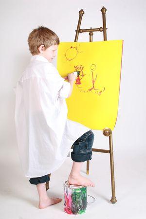 a child working on his kindergarten artwork photo