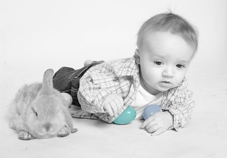 Little baby boy with Easter bunny and colorful eggs Stock Photo - 828178