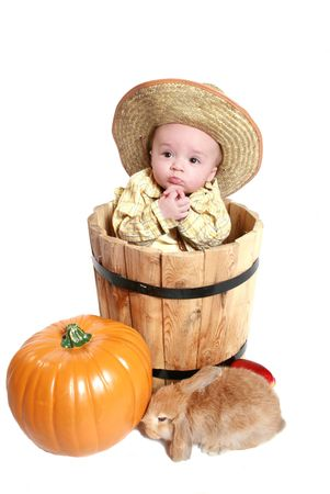 country baby with cowboy had and pumpkin