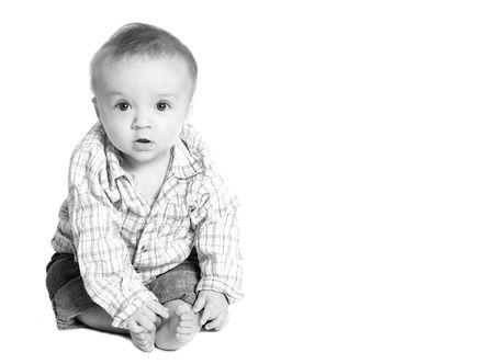 muchacho adorable del beb� con el espacio de la copia en foto. Foto de archivo