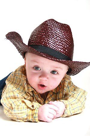 cute little baby boy wearing a cowboy hat.