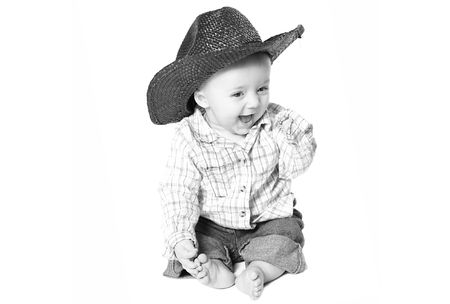 smiling baby boy with a cowboy hat. Archivio Fotografico