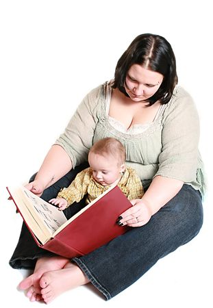 learing: mother reading to her infant child.  Its a big red book