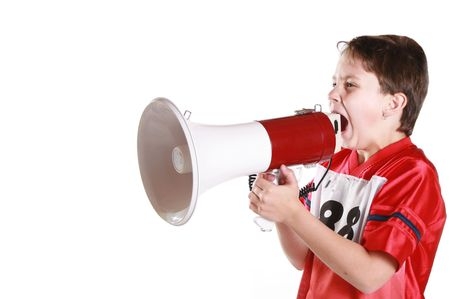 A young boy shouting in protest through a bullhorn.