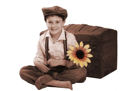Un ni�o sonriente para la c�mara, un retrato de �poca.  Foto de archivo