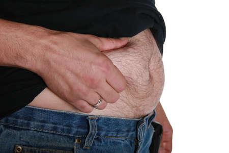 El hombre que muestra cu�nto peso ha ganado.  Foto de archivo