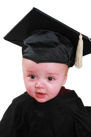 a baby in a graduation outfit.  A black cap and gown. Stock Photo