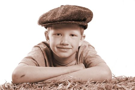 Vintage portrait of young boy with a very cute face.
