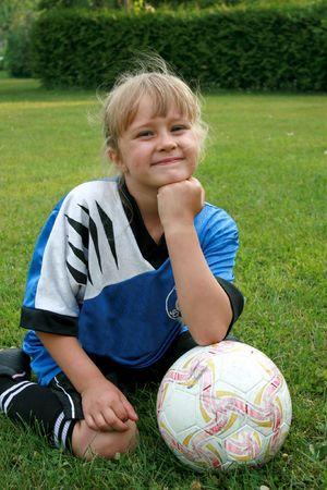 soccer cleats: Team portrait of soccer kid.