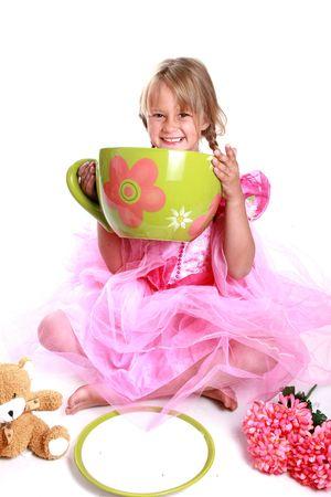 children party: Cute little girl having a tea party. Stock Photo