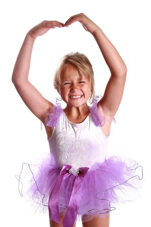 Adorable little girl learning to dance ballet.