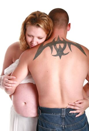 Tattoo on mans back  and holding his pregnant girlfriend photo