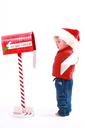 Little kid mailing a letter to santa claus Stock Photo
