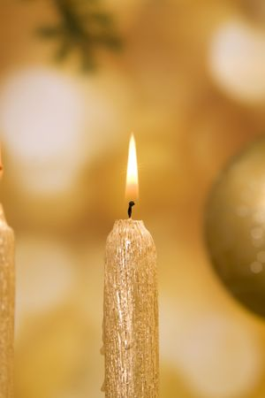 Christmas decorations and glittering candle