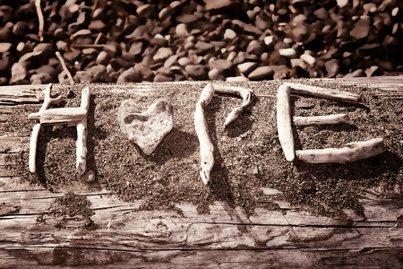 Words that spell hope are made out of sticks and stones photo