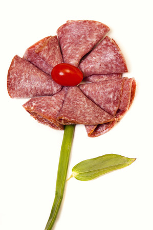 Lunch meat appetizer turned into a decorative daisy flower for dsiplay. Heathly snack choice.