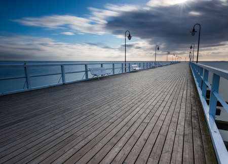 Beautiful pier in Gdynia, poland. Seascape with wooden molo in Orlowo. Landscape with long exposure effect Standard-Bild