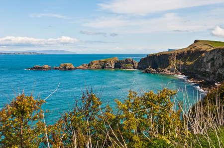 stunning seashore view to Carrick-a-Rede Rope Bridge in Northern Ireland Reklamní fotografie