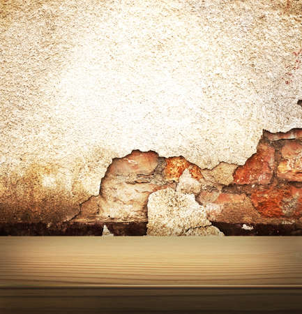 degrading: Damaged Wall Textured Background with Wood Platform