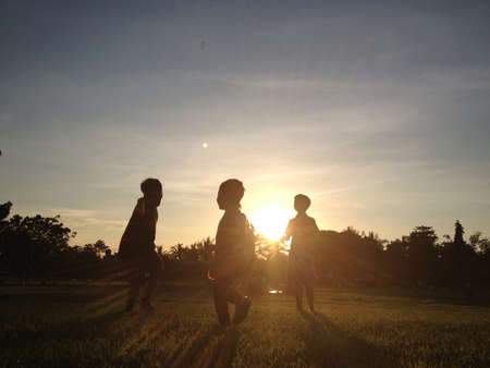 Kids playing outdoor during sunset