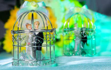wedding vows: Figurine Couple in Cage  Wedding Vows concept
