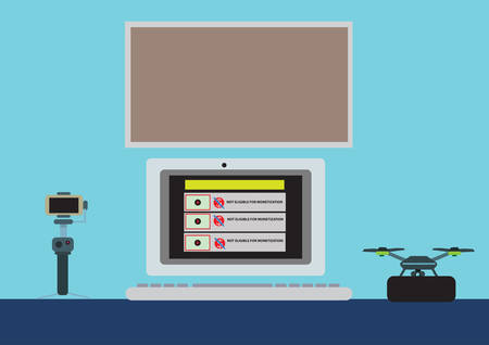 A laptop on a filmmakers table showing videos are not monetized on a certain video-sharing website. Illustration