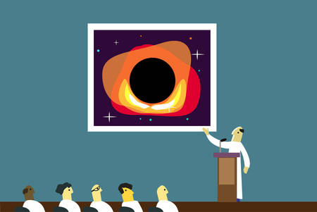 A scientists discusses a picture of a black hole in an assembly or forum
