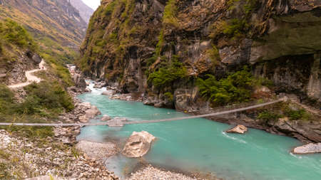 THE ROPE WAY CROSSING RIVER ON THE WAY ANNAPURNA CIRCUIT
