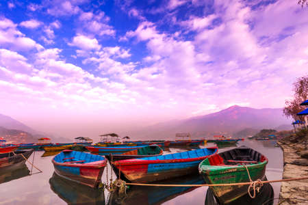 The Boats with different colors,The blue sky reflection in the water.view from Phewa Lake Pokhara Nepal.
