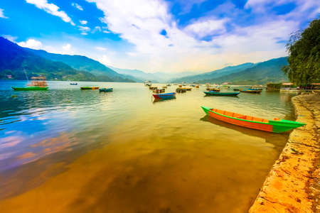 Passenger Boats Parking in phewa lake Sunset on Background. Pokhara Nepal