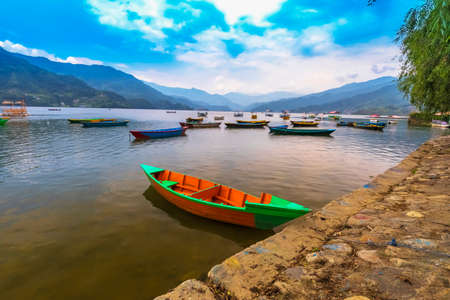 Nepal Boats, Main Attraction of phewa Lake,Pokhara on Background Blue clouds Sky.Pokhara Nepal. 写真素材