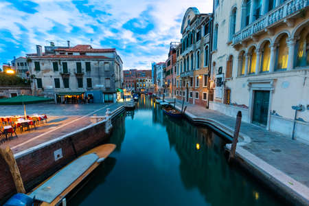 Narrow canal with Boats and Architecture and landmark of Venice.Italy