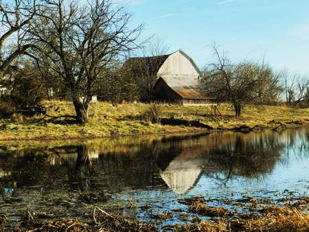 Barn reflecting in pond