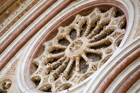 Detail of rose window, with traces of golden mosaic at Basilica of St. Francis, Assisi, Italy